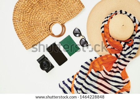 High angle view of hat bag digital camera mobile phone and documents prepared for summer holidays isolated on white background #1464228848