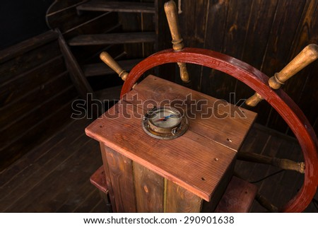 High Angle View of Helm of Antique Wooden Ship with Compass and Steering Wheel on Deck