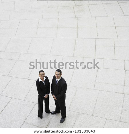 High angle view of Hispanic businesspeople