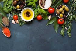 High Angle View of Italian Food IngredientsBbackground with Herbs, Olives, Oil and Tomatoes. Empty space for your text