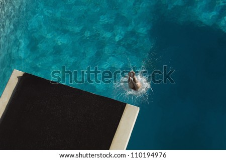 High angle view of legs of a diver diving in pool