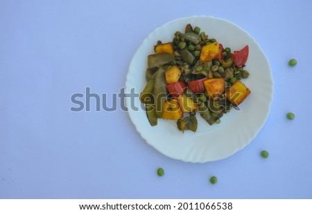 High angle view of matar paneer mix veg recipe (Indian food) over white background with copy space  Foto stock ©
