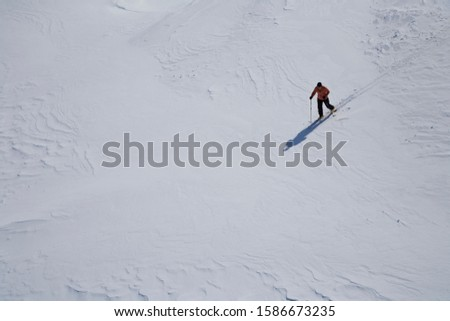 High angle view of mid adult man cross-country skiing in snow
