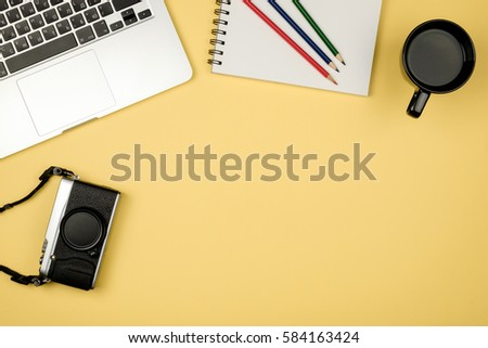 High angle view of office colored desk with copy space. Table with laptop and supplies. Top view. Flat lay. Freelancer or student desk #584163424