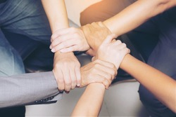 High Angle View Of people linking hands