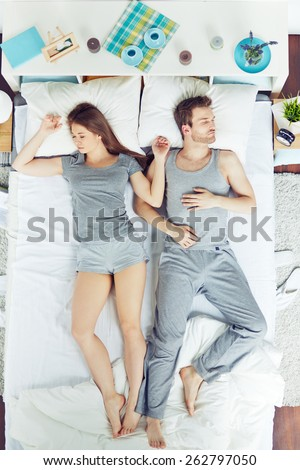 High angle view of people sleeping in bed