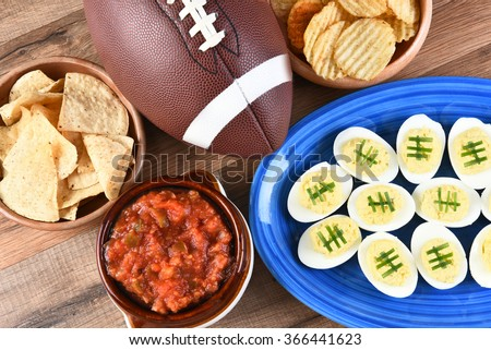 Shutterstock High angle view of snacks for watching a football game. Great for Super Bowl or Playoff themed projects.