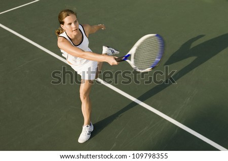 High angle view of sporty female playing on tennis court