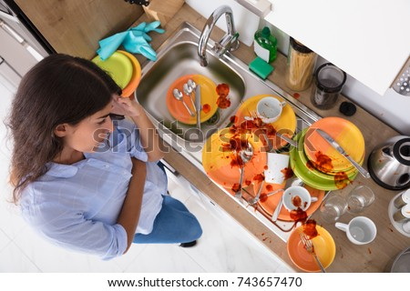 Shutterstock High Angle View Of Stressed Young Woman Looking At Unwashed Utensils In Kitchen