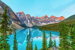 High angle view of summer sunrise lighting up the Valley of the Ten Peaks at Moraine Lake near Lake Louise in the Canadian Rockies of Banff National Park, Alberta, Canada.