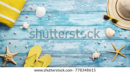 High angle view of summer, vacations, beach accessories on blue wooden background with copy space