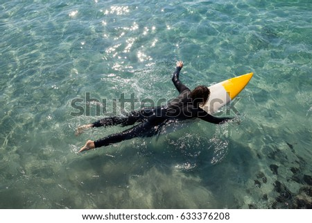 High angle view of surfer surfing in the sea on a sunny day