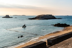 High angle view of the beach of Saint-Malo from ramparts at sunset. Brittany, France, Europe