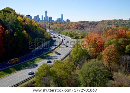 High angle view of the colorful highway traffic in autumn with the downtown skyline stock photo