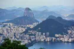 High angle view of the urban area of Rio de Janeiro, Brazil, with Sugarloaf Mountain and the hazy mountain range in the background