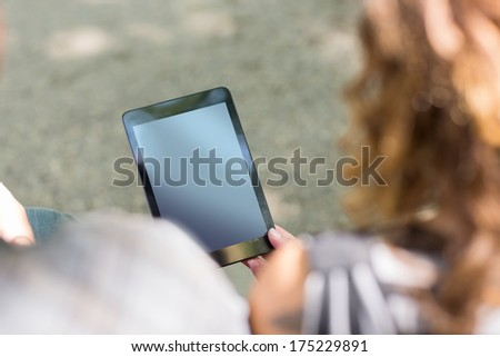 High angle view of university students holding digital tablet at campus