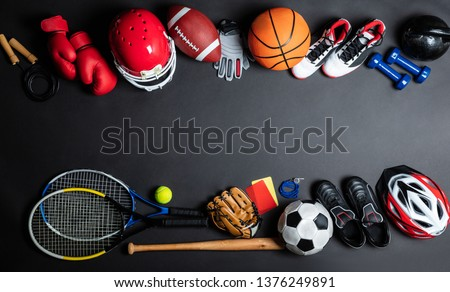 High Angle View Of Various Sport Equipment On Black Background #1376249891