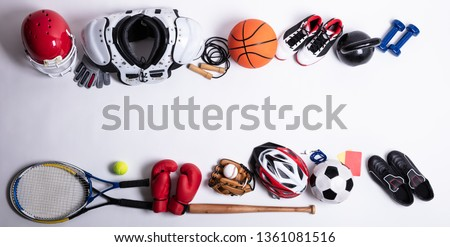 High Angle View Of Various Sport Equipment On White Background