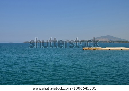 High angle view  oh a  quay on Ionian sea water in  Greece near Corfu island  .Scenic view of   sea against clear blue sky and islands . #1306645531
