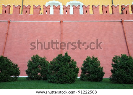 high brick wall of the Kremlin. Russia, Moscow.