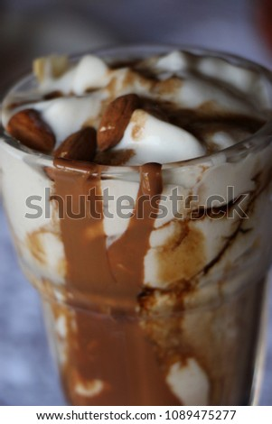High caloric shake and frozen fast food drink concept with a glass