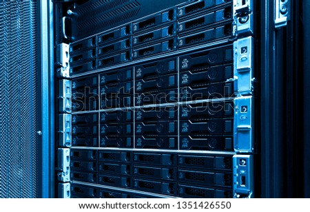 High capacity hard drive disk storage rack used for big data cloud services inside data server room close up