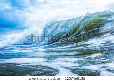 High clarity photo if crashing wave in stopped motion #1207468135