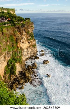 High Cliff at Uluwatu Temple, Bali, Indonesia - A scenic Uluwatu Cliff with pavilion and blue sea in Bali Indonesia.