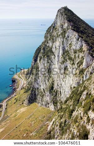 High cliffs of Gibraltar Rock by the sea in southern part of Iberian Peninsula.
