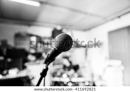 high contrast black and white close up of a microphone on a band rehearsal place with a very shallow depth of field (music)