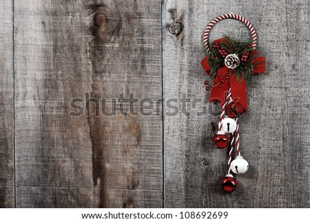 High contrast grunge Christmas decoration hanging on wood