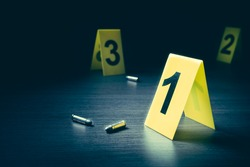 High contrast image of a crime scene with evidence markers