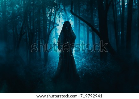 Photo of  High contrast image of a scary ghost in the woods