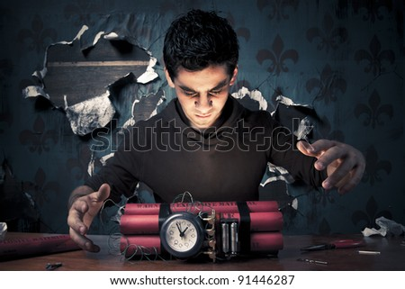 high contrast image of a terrorist making a time bomb