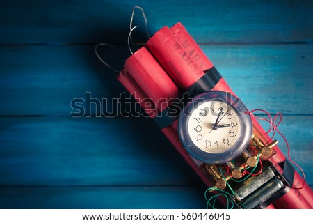 High contrast image of a time bomb on a wooden background #560446045
