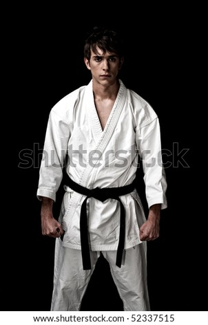High Contrast karate male fighter on black background.