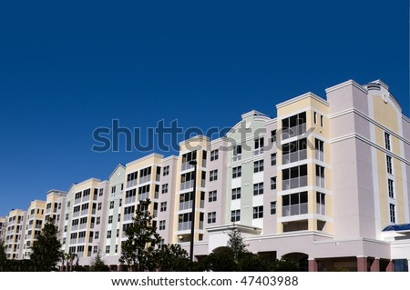 High contrast multi colored high rise condominiums with individual balconys and large area for text