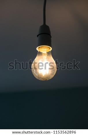 High contrast photograph of an isolated illuminated light bulb #1153562896