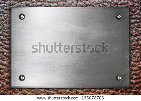 High detailed metal plate sign with screws on leather surface