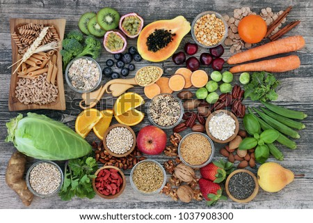 High dietary fibre health food concept with fruit, vegetables, whole wheat pasta, legumes, cereals, nuts and seeds  with foods high in omega 3, antioxidants, anthocyanins, smart carbs and vitamins. #1037908300
