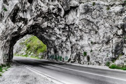 High dynamic range (hdr) photo of the road and the tunnel in the rock