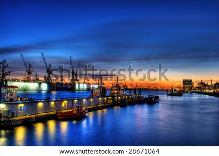 high dynamic range or hdr image of the port in Hamburg, Germany. industrial area at dusk or dawn. (tourist area).