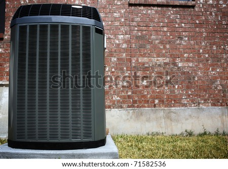 High efficiency modern AC-heater unit, energy save solution in front of brick wall - stock photo