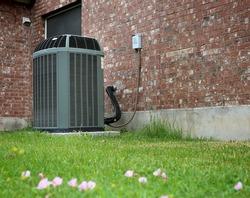 High efficiency modern AC-heater unit on brick wall background