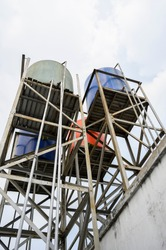 high elevation construction of fiber toren for clean water storage tanks of the house with pipe installation and its pillars or supporting poles
