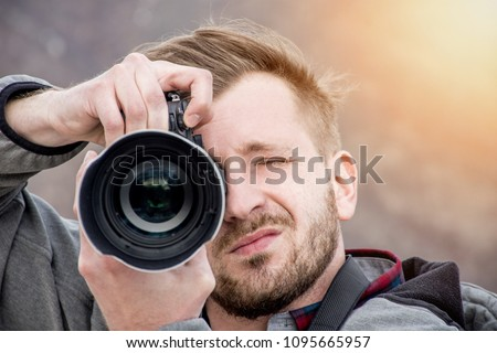 High end camera user.  Camera operator. Photographing the photographer. #1095665957