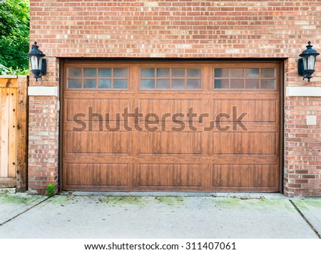 High End Garage Door On A Brick House Of A Upscale. Sliding Glass Door Curtain. Wood Pallet Doors. Replacement Flap For Dog Door. Garage Sales Signs. Metal Door Repair. Garage Wall Systems Lowes. Garage Lifts. Garage Sauna