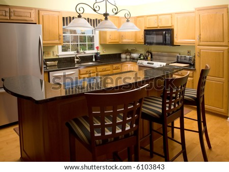 high end luxury modern kitchen with granite counter tops
