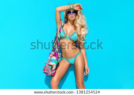 High fashion colors,Glamour Portrait of pretty beautiful fashion woman in bikini posing in summer near the sea and blue sky in sunshine with gorgeous sunglasses,tropic island girl on vacation - Image #1381254524