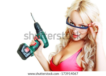 High fashion glamour blondy model in pink top looking through safe glasses